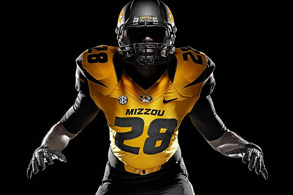 Mizzou football player on black background